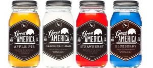 Four Jars of Great America Moonshine in Different Flavors on White Background