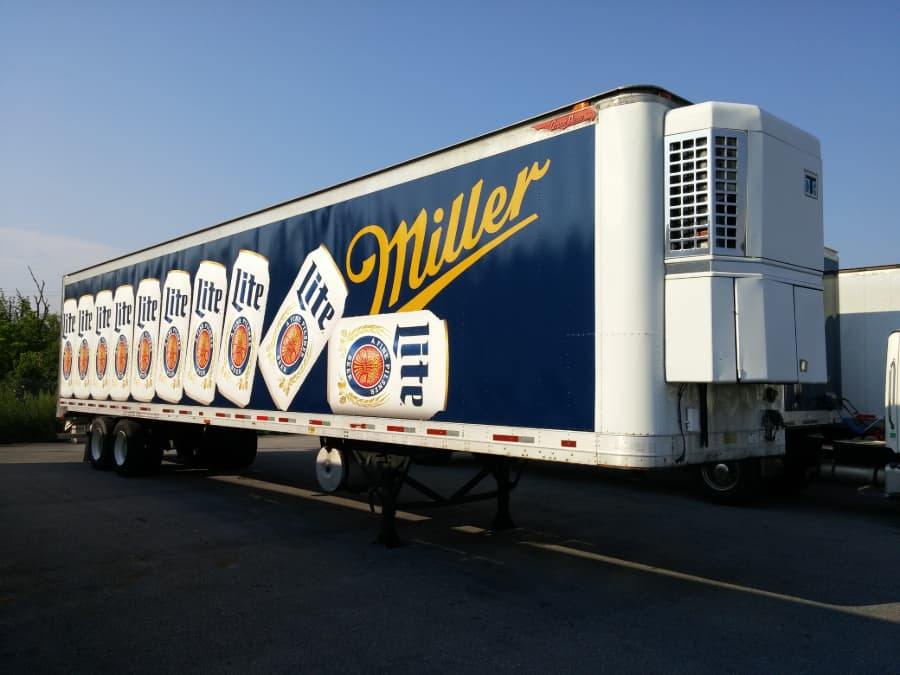Refrigerated Miller Lite truck in parking lot